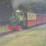 Green steam train with carriages