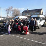 Group of people in front of minibus