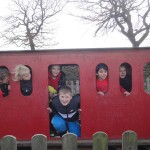 Children on a play train
