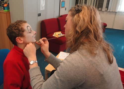 volunteer doing facepainting